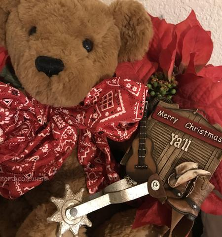 cowboy teddy bear with Christmas ornament