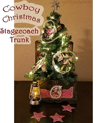 Cowboy Christmas stagecoach trunk with mini Christmas tree